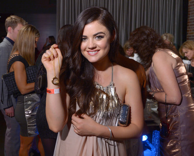 ABC's Pretty Little Liars actress Lucy Hale shows off her new personalized Origami Owl Living Locket(R) at Big Machine Label Group's CMA Awards After Party, co-sponsored by Origami Owl, on November 6, 2013.  (PRNewsFoto/Origami Owl)