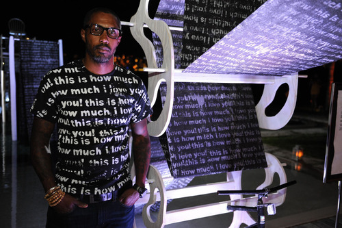 """John Cox at Art Basel Miami with """"this is how much I love you"""" series.  (PRNewsFoto/Baha Mar)"""