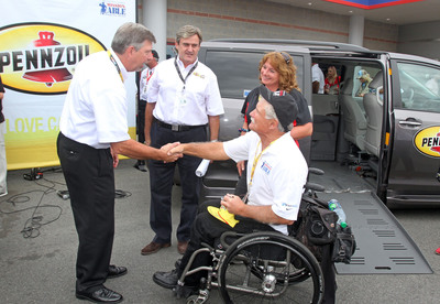 "Rusty Barron, Vice President of Marketing, Shell Lubricants, Istavan Kapitany, President of Shell Lubricants Americas, congratulate Hank Ebert on his brand new retrofitted 2013 Toyota Sienna XLE customized with hand controls and a wheelchair lift.  Ebert was awarded the customized van by Pennzoil through their commitment to Paralyzed Veterans of America's ""Mission: ABLE"" campaign on Saturday, October 12th, 2013 at Charlotte Motor Speedway.  (PRNewsFoto/Pennzoil)"