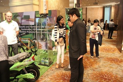 Attendees at Eco Tech Asia's booth - featuring bamboo luggage, 'APC Boo Bikes' and other environmentally friendly products. (PRNewsFoto/Asia Plantation Capital)
