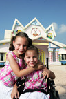 Sisters enjoying the Gingerbread House at Give Kids The World Village in Orlando, FL.  (PRNewsFoto/Perkins Restaurant & Bakery)