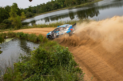 David Higgins and Co-Driver Craig Drew Sliding Between Lakes in Northern Minnesota at the Ojibwe Forest Rally