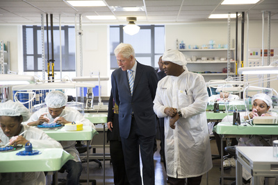 President Clinton (left) and Willie Holley (right) tour Shinola's watch factory.