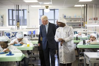 President Clinton (left) and Willie Holley (right) tour Shinola's watch factory.  (PRNewsFoto/Shinola)