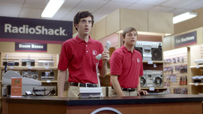 In a scene from RadioShack's surprise Super Bowl ad, two store associates show their shock as popular '80s entertainment icons rush the throwback RadioShack store to reclaim the technology of yesteryear. The ad sets the stage for RadioShack's new brand positioning and helps the company shed outdated perceptions.  (PRNewsFoto/RadioShack Corporation)