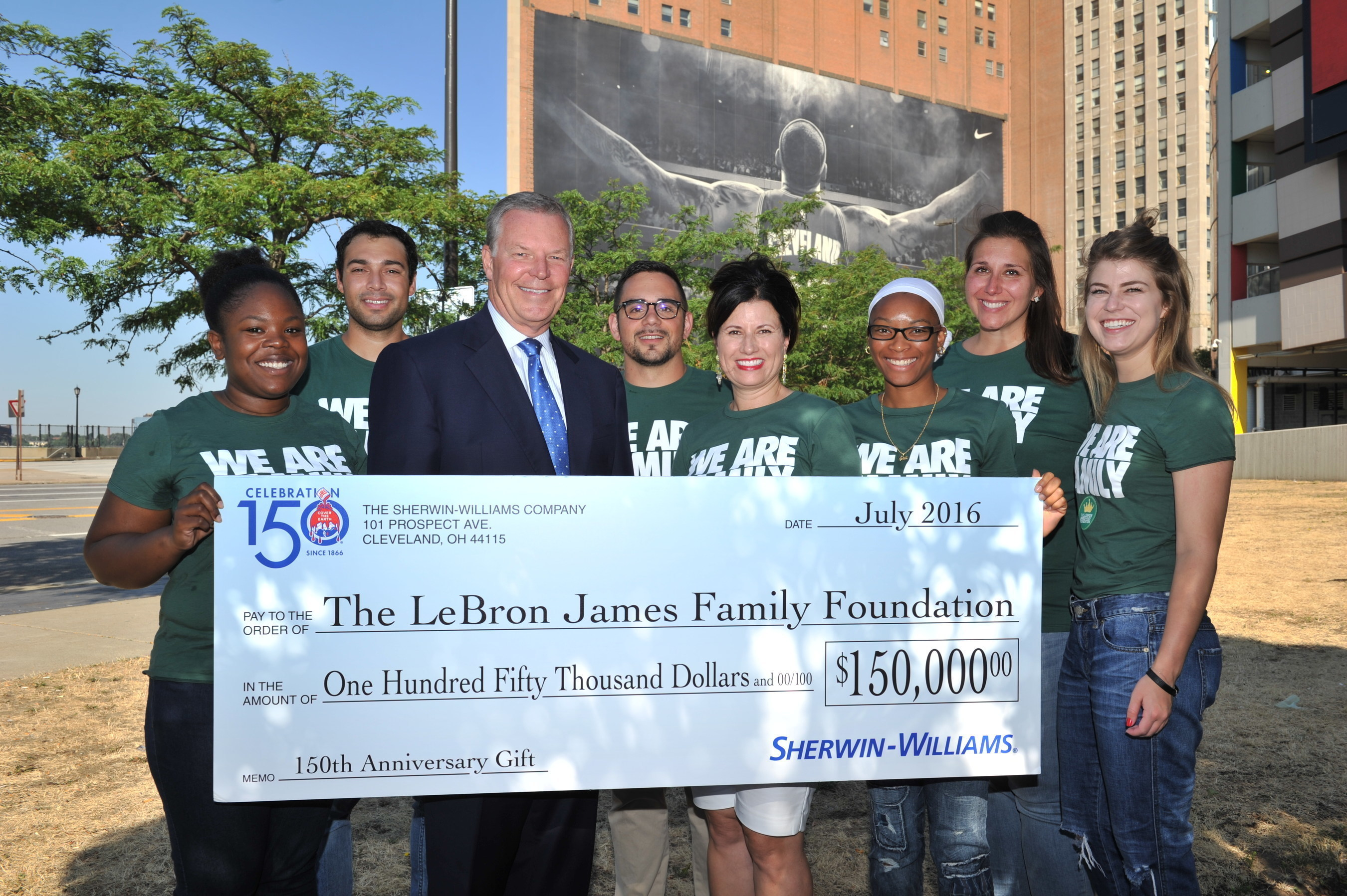 Sherwin-Williams Executive Chairman Chris Connor, Michele Campbell Executive Director of the LeBron James Family Foundation with team members.