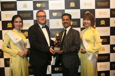 Rajnish Sabharwal COO TUTC accepting the award for Asia's Leading Luxury Camp at the World Travel Awards in Vietnam