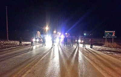On the Pine Ridge, SD Reservation, Native Americans confront Nebraska State Police in protest over illegal alcohol sales in Whiteclay, NE 2-28-13.  (PRNewsFoto/Alcohol Justice, Joseph Feaster)