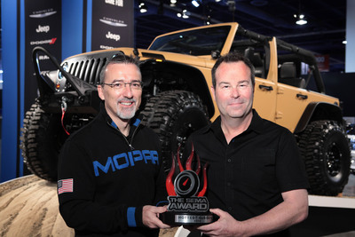 Pietro Gorlier, President and CEO of Mopar, Chrysler Group LLC's service, parts and customer care brand, accepted the 'Hottest 4x4 SUV' award for the Jeep(R) Wrangler at SEMA in Las Vegas, Oct. 30, 2012. Pictured with Gorlier is Mark Allen, Head of Jeep Design, and the Jeep(R) Wrangler Sand Trooper, one of 24 specially created Chrysler Group LLC vehicles unveiled at SEMA 2012.  (PRNewsFoto/Chrysler Group LLC)