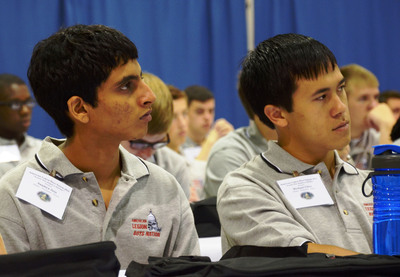 "The American Legion Boys Nation delegates Saumyar Jain of Illinois (left) and Michael Chen of Idaho watch a video greeting from program alumnus Bill Clinton. This week marks the 50th anniversary of the former president's participation in the Washington, D.C. based program. Clinton said Boys Nation had ""a profound impact"" on his decision to pursue a life of public service.  (PRNewsFoto/The American Legion)"