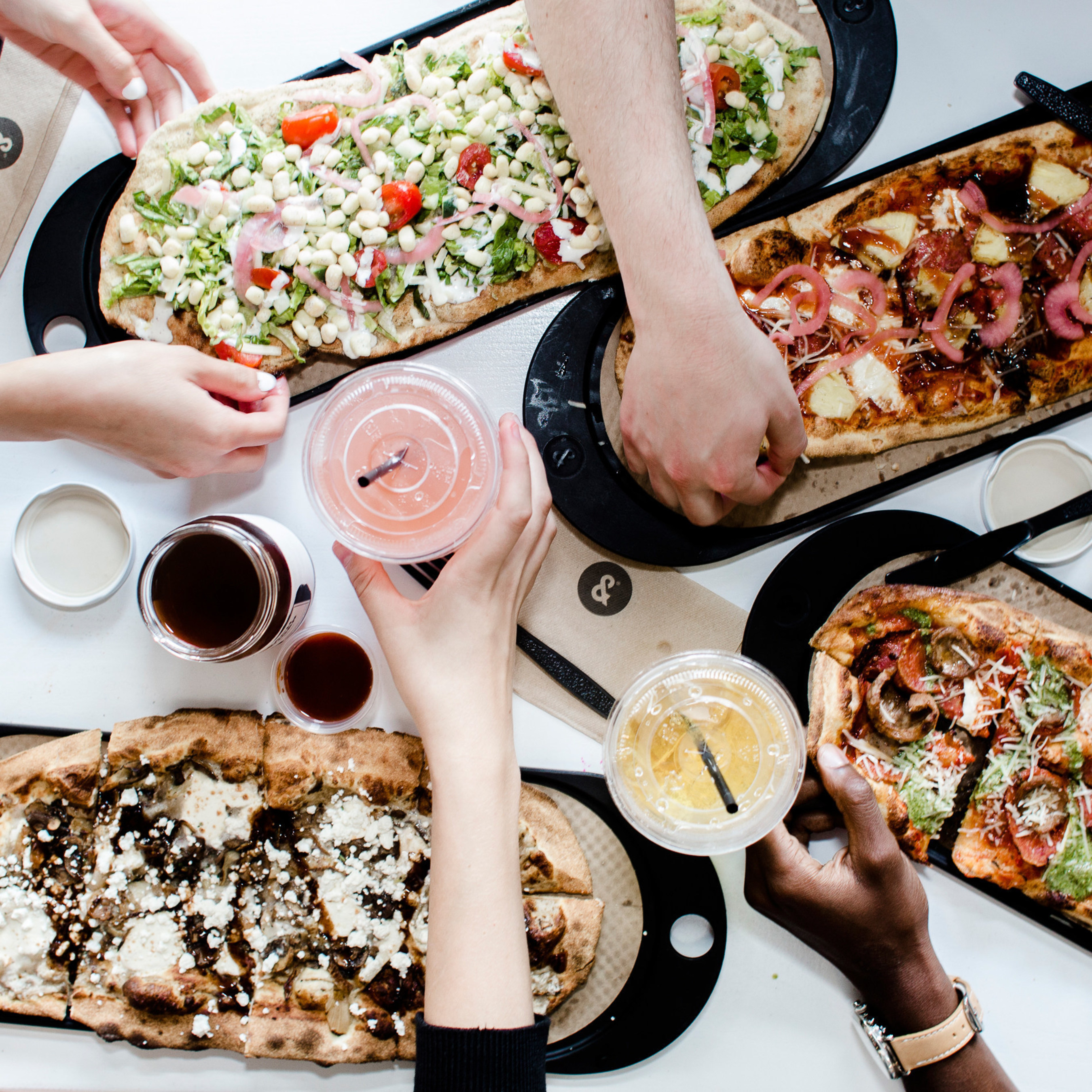 &pizza is the counterculture brand known for its critically acclaimed pizza and craft beverages, ampersand-tattooed employees (the Tribe), and fight for a living wage.