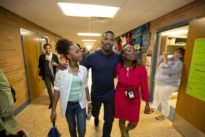 Minneapolis, MN – September 10, 2014: Quvenzhane Wallis, Jamie Foxx from Columbia Pictures' ANNIE at the Minneapolis Turnaround Arts Event with Principal Leona Derden at Norhport Elementary School in Brooklyn Park.