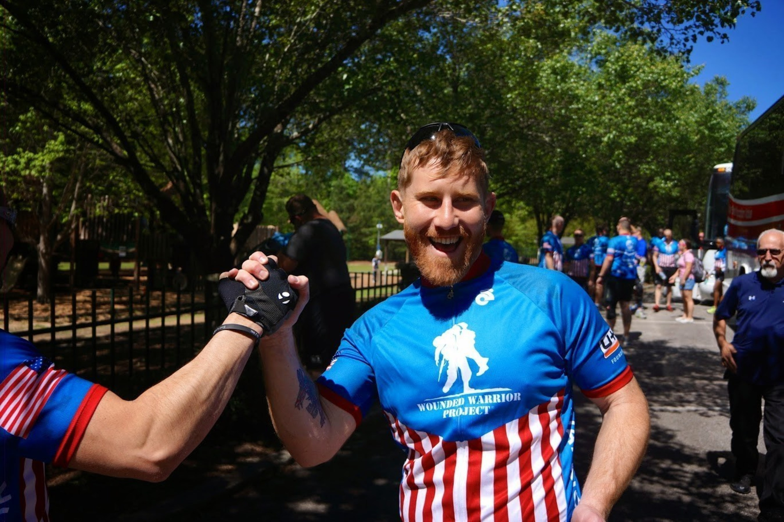 Injured service members celebrating during the 2015 Wounded Warrior Project Soldier Ride in Atlanta.