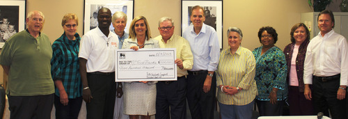 Food Lion President Beth Newlands Campbell (pictured center holding check) with executive directors of North ...