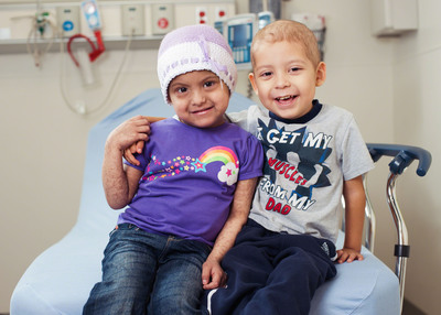 Radio stations across the country support St. Jude patients like Gigi and Estevan, the best of friends.  (PRNewsFoto/St. Jude Children's Research Hospital)