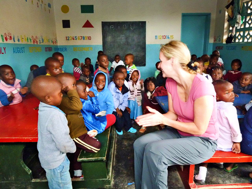 Gretchen Johnson, senior vice president for human resources at Travelzoo at an Open Arms foster home in Malawi. Photo Credit: Neville Bevis (PRNewsFoto/Travelzoo Inc. )