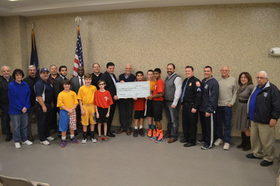 National Income Life SGA Theodore Pappas (holding check, left) presents $5,000 to Nassau County Police Activity League