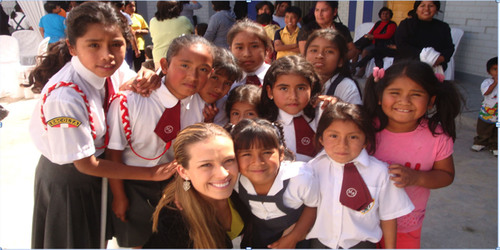 Petra Nemcova with students of the school, Maria Auxiliadora, in Ica, Peru. The school was built by the Happy ...