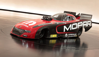 A new 2015 Mopar Dodge Charger R/T Funny Car drag racing vehicle unveiled at the SEMA.
