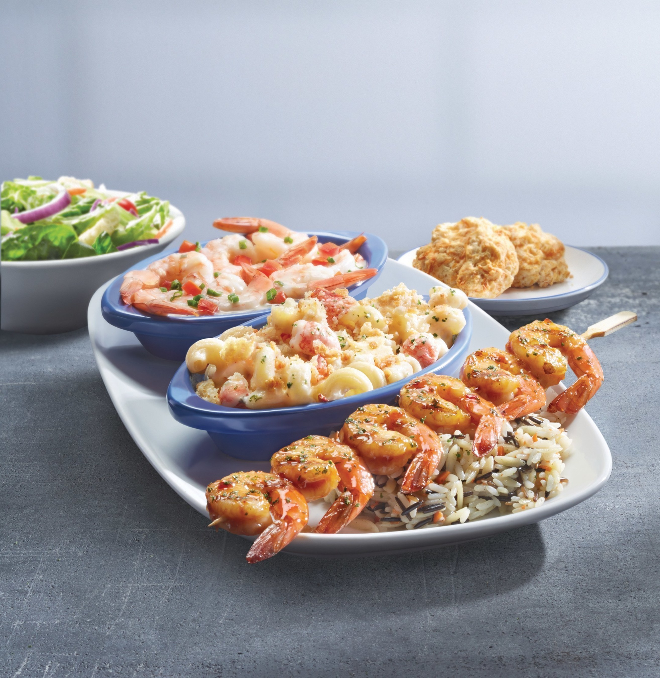 Red Lobster's Create Your Own Seafood Trio event lets guests mix and match flavors and preparations to build the perfect plate, like the NEW! Wood-Grilled Spicy Tennessee Bourbon Shrimp, Baked Lobster Alfredo and Lemon Garlic Butter Shrimp.