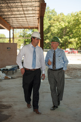 Congressman Timothy J. Ryan (left) joins Finance Fund CEO James R. Klein on a hard hat tour of the new $15.6 million Kent State University Hotel & Conference Center under construction using $9 million in New Markets Tax Credits from Finance Fund (financefund.org).  (PRNewsFoto/Kent State University)