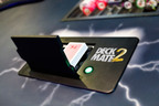 SHFL's DeckMate 2 poker room card shuffler will make its G2E Asia debut.  (PRNewsFoto/SHFL entertainment, Inc.)