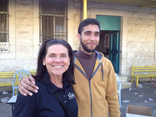 Local volunteer, Hatim (pictured, right, with Tani Austin, left) of the Foundation.  (PRNewsFoto/Starkey ...