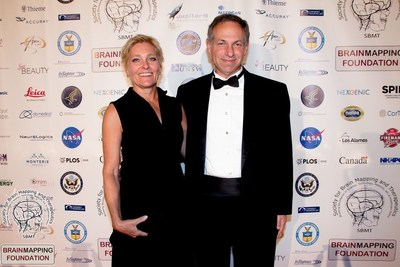 Former Lt. Colonel US Army Reserve, Aaron G. Filler, MD, PhD, FRCS, JD and his wife former Captain, US Air Force, Annelise Shaw. Dr Filler - awardee of the Pioneer in Medicine Award of the Society for Brain Mapping & Therapeutics (SBMT), is currently President and Counsel for SBMT. He is the lead inventor of Diffusion Tensor Imaging (DTI) the method that visualizes human brain tracts to detect brain injury in impact sports, accidents, and in war fighters in the field.