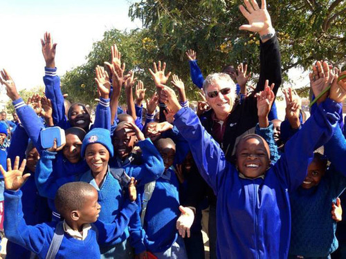 It Works! Global CEO Mark B. Pentecost with children in Africa.  (PRNewsFoto/It Works! Global(TM))