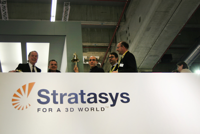 Spring SRL with Andy Middleton, Stratasys General Manager EMEA, ringing the bell following the purchase of their seventh Stratasys FDM 3D Printer.  (PRNewsFoto/Stratasys Ltd.)