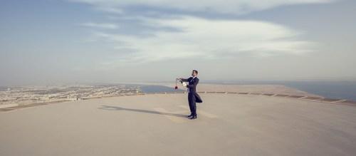 A St. Regis butler sabers a Champagne bottle atop The St. Regis Abu Dhabi Helipad (PRNewsFoto/The St Regis Abu ...