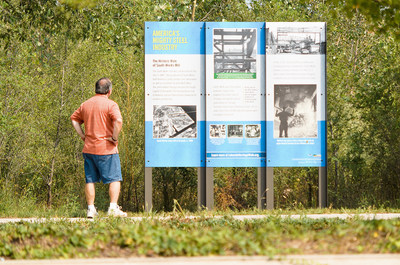 The Lakeside Heritage Walk trail signs illustrate the site's cultural and industrial past as well as its redevelopment and emerging biodiversity--from its still standing ore walls to its future as a thriving green community.