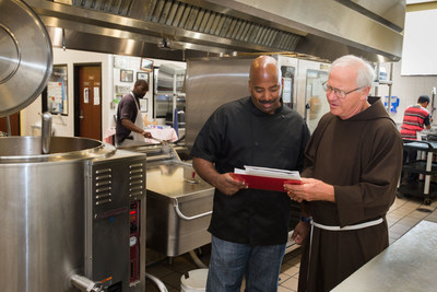 Capuchin Soup Kitchen Chef, Jay Brown (left) and Brother Jerry Smith go over the day's menu amidst new kitchen equipment donated through a makeover by DTE Energy and DNV GL.