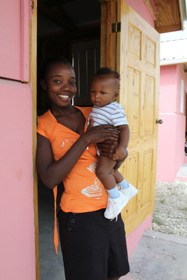 New Habitat homeowner, Nathalie Saint Germanin, and her son, stand in front of their house. More than 150 families moved into their homes in Habitat for Humanity's Santo community in Leogane, Haiti.  (PRNewsFoto/Habitat for Humanity International, Nixon Cyprien)