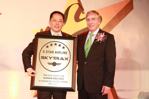 Skytrax Chairman Edward Plaisted once again presented the Skytrax Five-Star Airline certificate to Hainan Airlines Chairman Chen Ming.  (PRNewsFoto/Hainan Airlines)