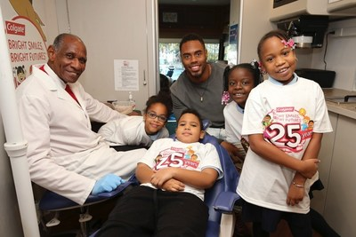 New York Giants running back Rashad Jennings (center) and Dr. Paul Martin (far left), a Colgate Bright Smiles, Bright Futures dental professional coordinator, remind P.S./I.S. 76 students about the importance of maintaining good oral health habits during the Bright Smiles, Bright Futures 25th Anniversary celebration in New York City. (Mark Von Holden/AP Images for Colgate Bright Smiles, Bright Futures)