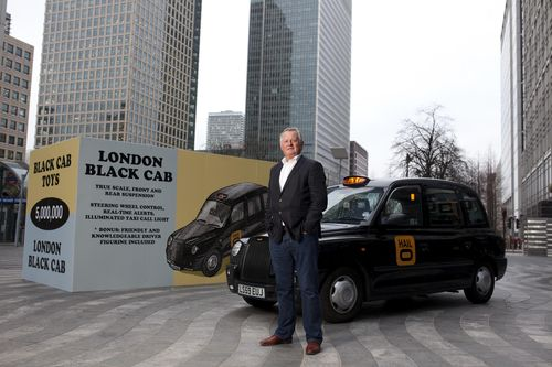Russell Hall, a former taxi driver and Co-Founder of taxi app Hailo, stands in front of a giant toy box, measuring 2.5 metres by 5 metres, to celebrate the forthcoming launch of their new service, Hailo for Business, in Montgomery Square, Canary Wharf in London. PRESS ASSOCIATION Photo. The new service will open up Hailo's fleet of 14,000 knowledgeable drivers to London businesses, allowing busy professionals to make real-time bookings on the move. Photo credit: David Parry/PA (PRNewsFoto/Hailo)