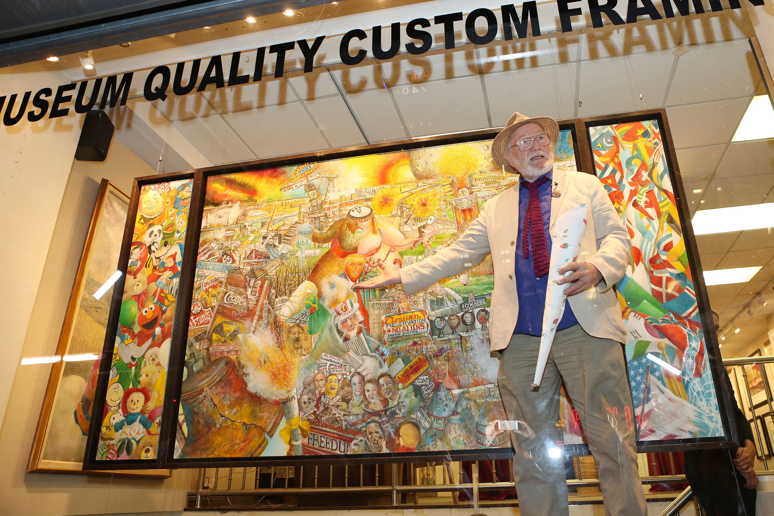Artist Robert Cenedella at the unveiling of his painting, Fin del Mundo (End of the World) in Manhattan. (Credit: Krista Kennell/PMC)