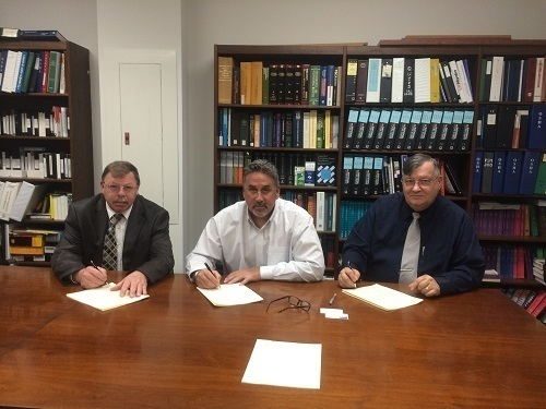 From Left: Kenneth C. Tucker, lll (Director, CONN-OSHA Wethersfield, CT Office); Anthony Maselli (Vice President of Field Operations, KBE); and Robert W. Kowalski (Area Director, Bridgeport , CT Area OSHA Office). (PRNewsFoto/KBE Building Corporation)