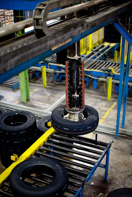 Continental and General brand commercial vehicle tires leave the production line at the Continental Tire the Americas, LLC tire facility in Mt. Vernon, Ill. CTA announced today a $129 million investment in the facility.  (PRNewsFoto/Continental)