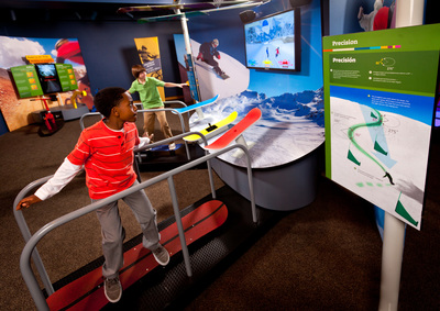 Visitors learn that math is all around them as they ride a snowboard simulator at Raytheon's MathAlive! interactive museum exhibit, coming to the Museum of Science, Boston.