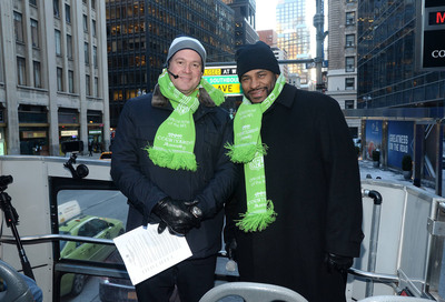 """Courtyard by Marriott surprised a bus full of football enthusiasts with an unforgettable treat - Jerome """"The Bus"""" Bettis driver and Rich Eisen tour guide.  (PRNewsFoto/Courtyard by Marriott)"""