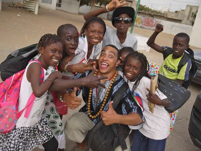 Raw Material's Wu-Lu with Senegalese children at Feta2h Festival, Senegal. Wu-Lu is now on his way to New York City on a DJing and production sabbatical for several months.