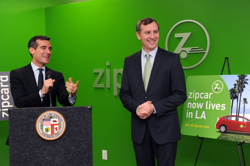 L.A. City Council President Eric Garcetti (left) and Zipcar President and COO Mark Norman (right) officially unveil Zipcar's new office space in Los Angeles during a press conference on November 10, 2011.  (PRNewsFoto/Zipcar, Inc.)