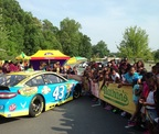 NASCAR driver Aric Almirola arrived in his No. 43 Ford to surprise the students at Sugar Creek Charter School on Wednesday as part of the Nathan's Famous & KaBOOM! Ready. Set. PLAY. event (PRNewsFoto/Nathan's Famous)