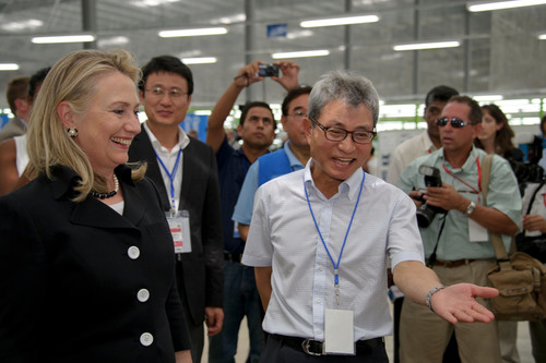 Sae-A Chairman Woong-Ki Kim explains Haiti factory facilities to Hillary Clinton US Secretary of State (Left: ...