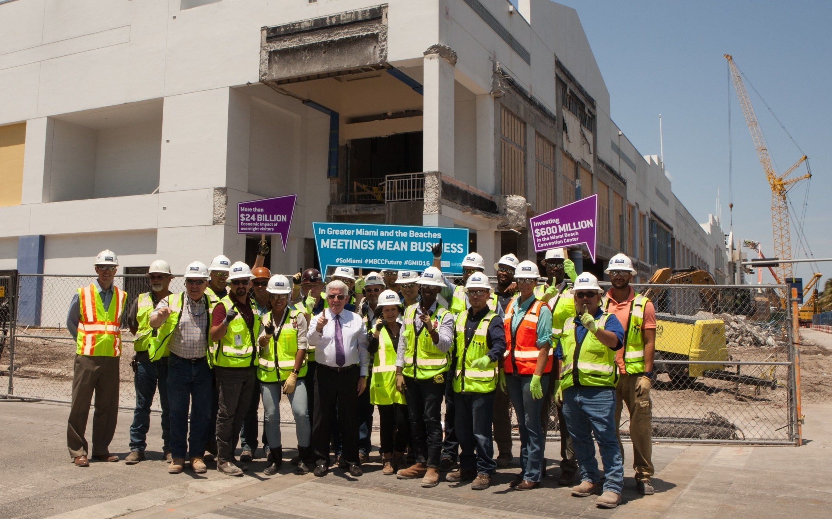 To celebrate Global Meetings Industry Day, Greater Miami Convention & Visitors Bureau (GMCVB) President and CEO William Talbert poses at the construction site of the Miami Beach Convention Center alongside the Clark Construction team working on the renovation and expansion of the existing building.