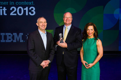 Werner Kruck, Security First Insurance Company Chief Operating Officer accepting the 2013 IBM Smarter Commerce Award at the IBM Smarter Commerce Global Summit held in Nashville, Tenn. (Pictured left to right): Craig Hayman, General Manager, IBM Industry Solutions, Werner Kruck, and Maria Winans, IBM Vice President, Worldwide Industry Solutions Marketing.  (PRNewsFoto/Security First Insurance Company)
