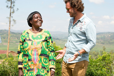 TOMS Founder Blake Mycoskie meets with a coffee farmer whose farm gives TOMS Roasting Co. its Rwanda roast beans.  (PRNewsFoto/TOMS)
