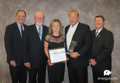 energybank wins First Place, Wisconsin Governor's New Product Award. (left to right) Mark R. Hogan, Secretary & CEO, Wisconsin Economic Development Corporation; Dale R. Swenson, P.E., Wisconsin Society of Professional Engineers (WSPE); Becky Verfuerth, Manager of Operations, energybank; Neal R. Verfuerth, Founder & CEO, energybank; John M. Parisi, P.E., President, WSPE. www.energybankinc.com